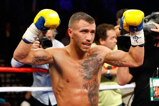 Vasyl Lomachenko gloves raised
